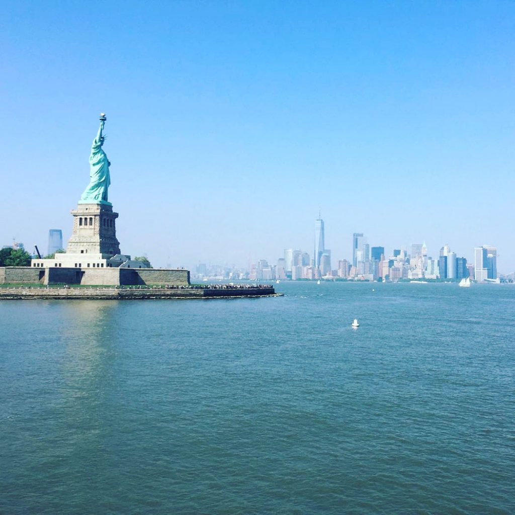 Statue of Liberty and New York Skyline by Emma Eats & Explores