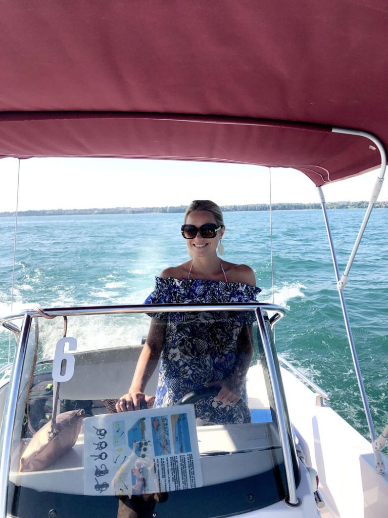 Driving our rentail boat on Lake Garda